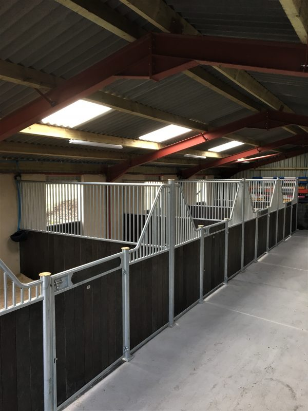 Internal stables in a barn in recycled plastic