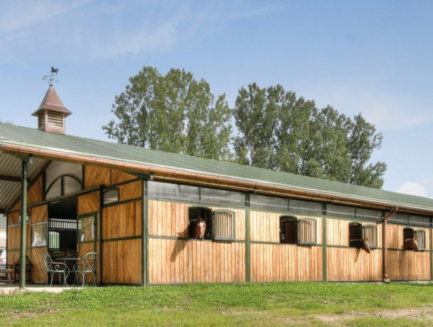 American barn horse stables with windows and clock tower